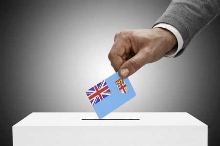 elect: Ballot box painted into national flag colors - Fiji Stock Photo