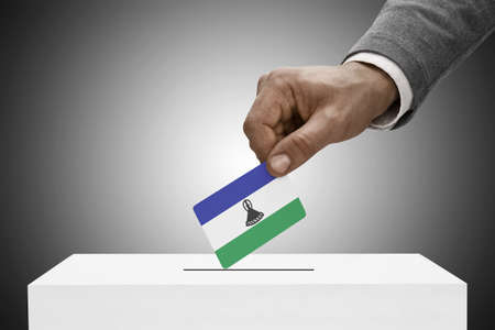 electoral system: Ballot box painted into national flag colors - Lesotho Stock Photo