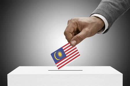 elect: Ballot box painted into national flag colors - Malaysia