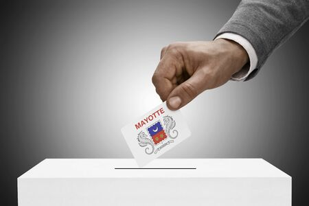 mayotte: Ballot box painted into national flag colors - Department of Mayotte Stock Photo