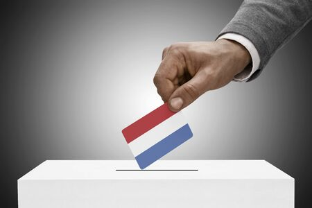 elect: Ballot box painted into national flag colors - Netherlands