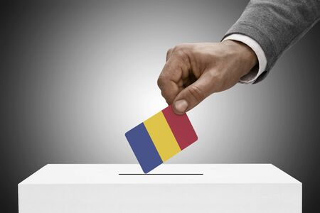 electoral: Ballot box painted into national flag colors - Romania Stock Photo