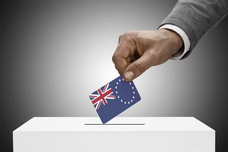 elect: Ballot box painted into national flag colors - Cook Islands Stock Photo