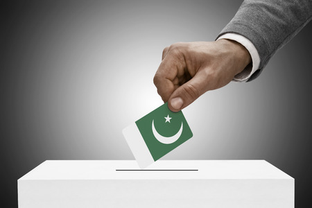 elect: Ballot box painted into national flag colors - Pakistan Stock Photo