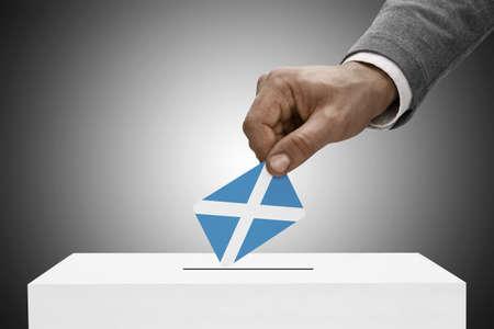 scottish parliament: Ballot box painted into national flag colors - Scotland Stock Photo
