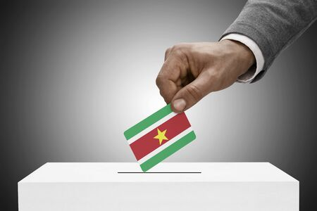 elect: Ballot box painted into national flag colors - Surinam Stock Photo