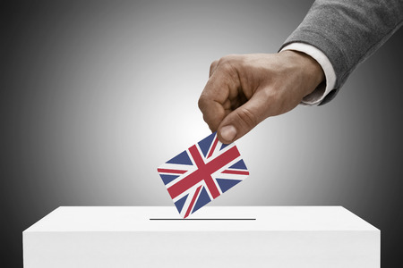 inserting: Ballot box painted into national flag colors - United Kingdom Stock Photo