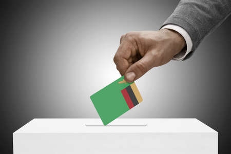 elect: Ballot box painted into national flag colors - Zambia
