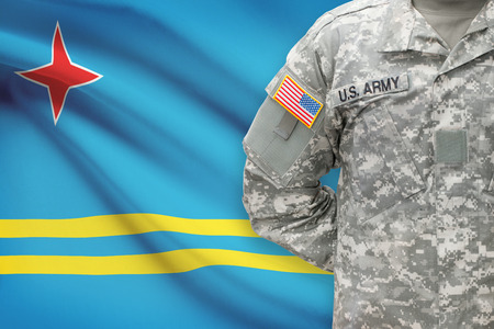 aruba flag: American soldier with flag on background - Aruba