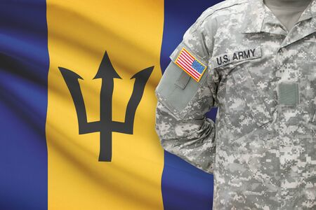 barbadian: American soldier with flag on background - Barbados Stock Photo