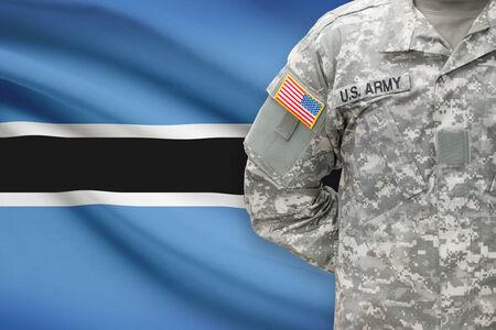 botswanan: American soldier with flag on background - Botswana