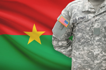burkina faso: American soldier with flag on background - Burkina Faso