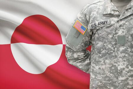 greenlandic: American soldier with flag on background - Greenland Stock Photo