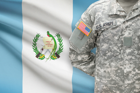 united states air force: American soldier with flag on background - Guatemala Stock Photo