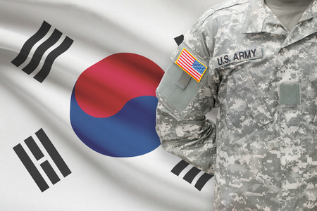 united states air force: American soldier with flag on background - South Korea Stock Photo
