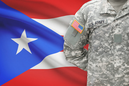 puerto rican flag: American soldier with flag on background - Puerto Rico