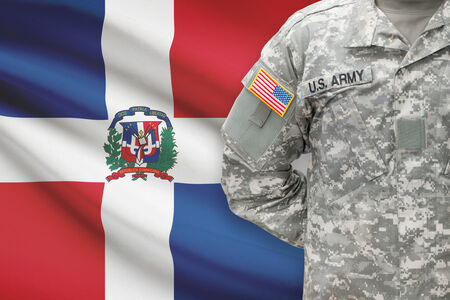 dominican republic: American soldier with flag on background - Dominican Republic Stock Photo