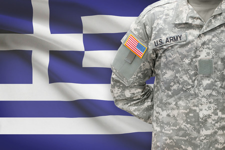 American soldier with flag on background - Greece - Hellenic Republic photo