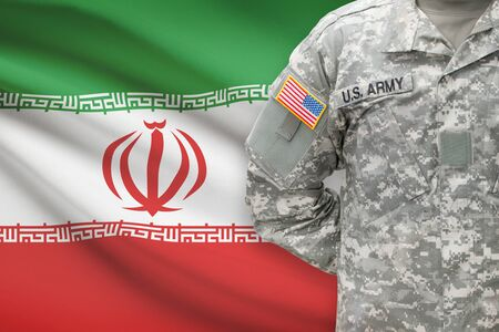 American soldier with flag on background - Iran photo