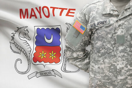 mayotte: American soldier with flag on background - Mayotte