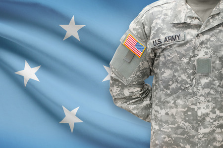 federated: American soldier with flag on background - Federated States of Micronesia
