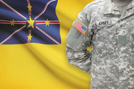 niue: American soldier with flag on background - Niue