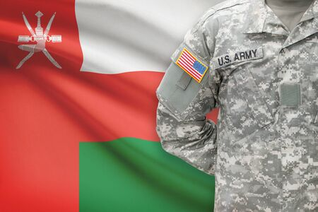 oman background: American soldier with flag on background - Oman
