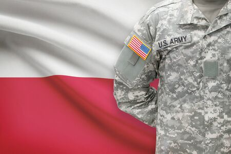 united states air force: American soldier with flag on background - Poland