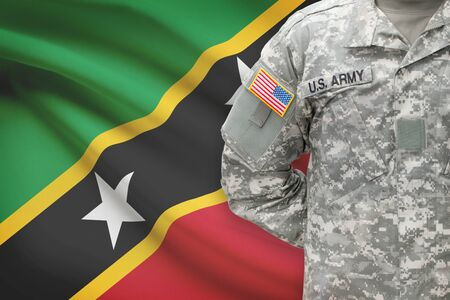 united states air force: American soldier with flag on background - Saint Kitts and Nevis