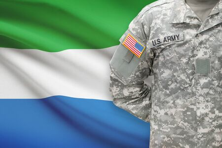 united states air force: American soldier with flag on background - Sierra Leone