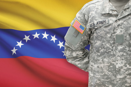 American soldier with flag on background - Venezuela Imagens