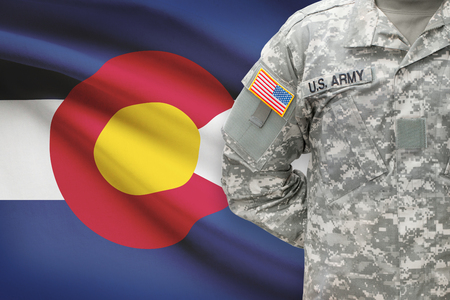 us soldier: American soldier with US state flag on background - Colorado