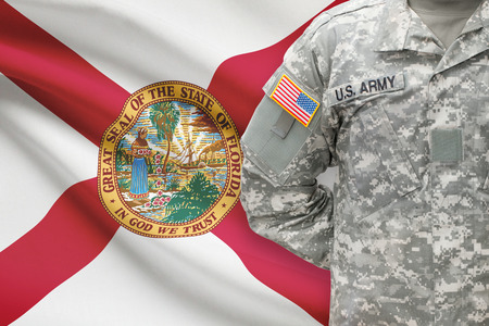 floridian: American soldier with US state flag on background - Florida