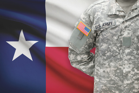 military special forces: American soldier with flag on background - Texas