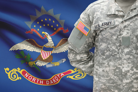 north dakota: American soldier with US state flag on background - North Dakota