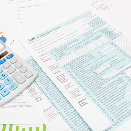 taxable income: US 1040 Tax Form and calculator - studio shot