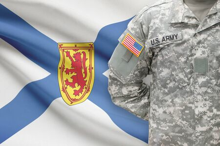 nova: American soldier with Canadian province flag on background - Nova Scotia Stock Photo
