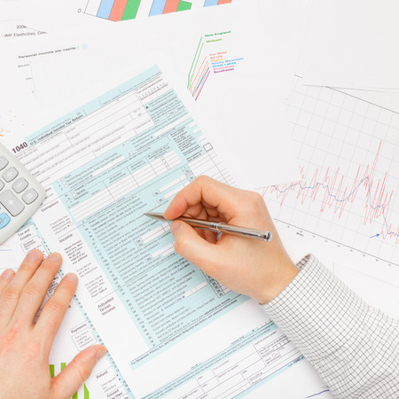 taxable income: Filling out 1040 US Tax Form - studio shot