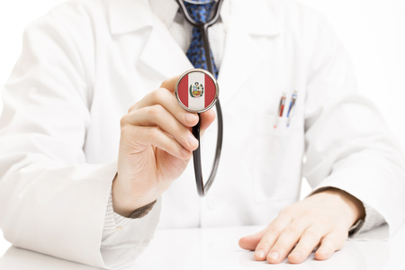 national trust: Doctor holding stethoscope with flag series - Peru Stock Photo