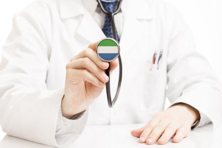 sierra leone: Doctor holding stethoscope with flag series - Sierra Leone