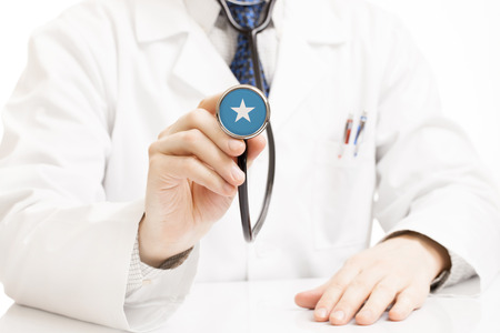 somali: Doctor holding stethoscope with flag series - Somalia