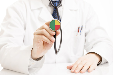 benin: Doctor holding stethoscope with flag series - Benin Stock Photo