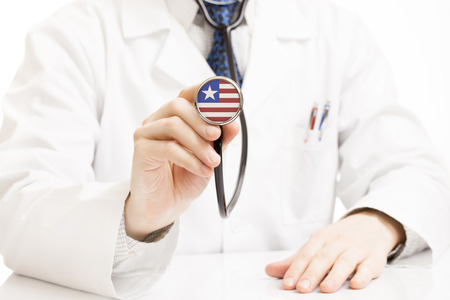 national trust: Doctor holding stethoscope with flag series - Liberia