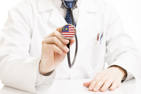 national trust: Doctor holding stethoscope with flag series - Malaysia Stock Photo