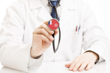 wallis: Doctor holding stethoscope with flag series - Wallis and Futuna Stock Photo