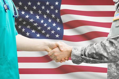 healthcare: Soldier and doctor shaking hands. Flag on background - United States