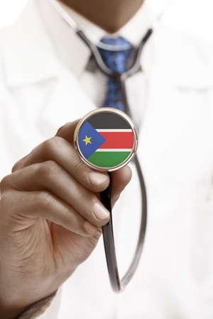 south sudan: Stethoscope with national flag conceptual series - South Sudan