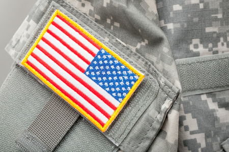US flag shoulder patch on solders uniform - studio shot