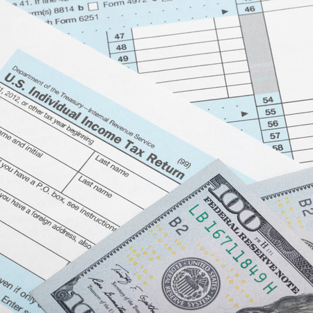 Tax Form 1040 With Two 100 Dollars Banknotes Stock Photo Picture