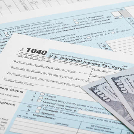 taxable income: Hundred dollars with US 1040 Tax Form